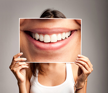 Frisco Elm Dental - Dr. Vidya Suri Little Elm area patients ask, 'What is the cost of professional teeth whitening services?'