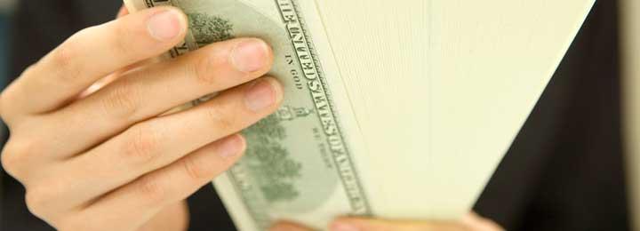 Dental Savers Plan Little Elm - Money in hand